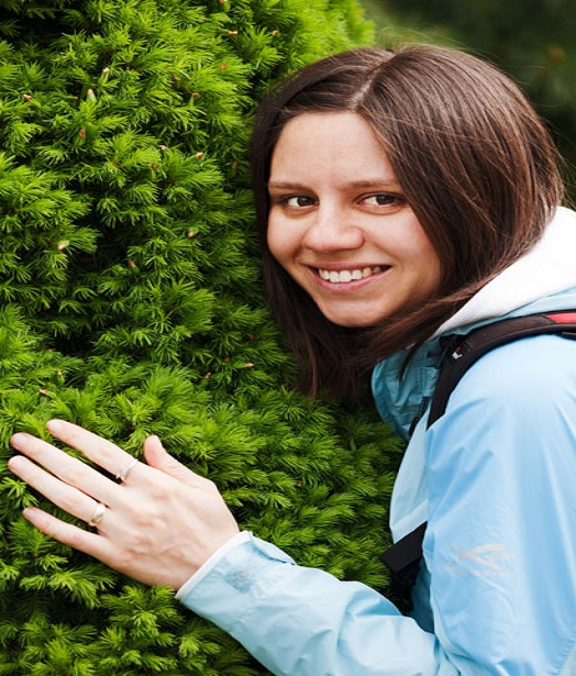 happy woman hugging shrubbery